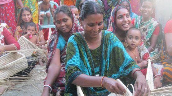 A basket artisan from Norapara village