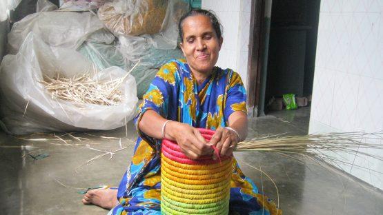 An artisan weaves a colourful work of art