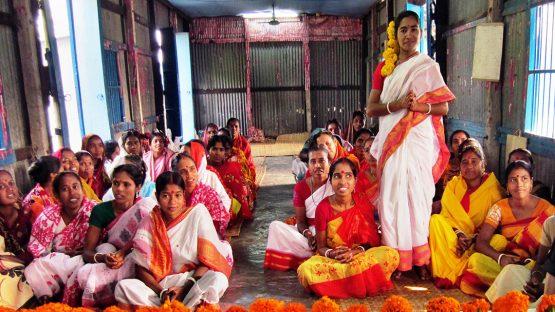 The women of Keya Palm Enterprises, wearing their springtime saris