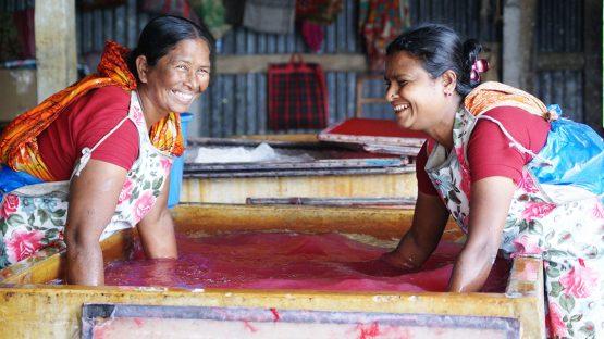 Renu Begum and Melina Sarkar making silk paper