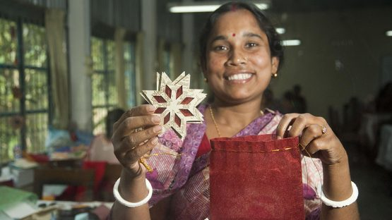 Champa Halder, a paper artisan displaying a beautiful Christmas decoration