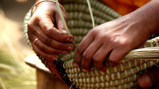 Weaving kaisa baskets