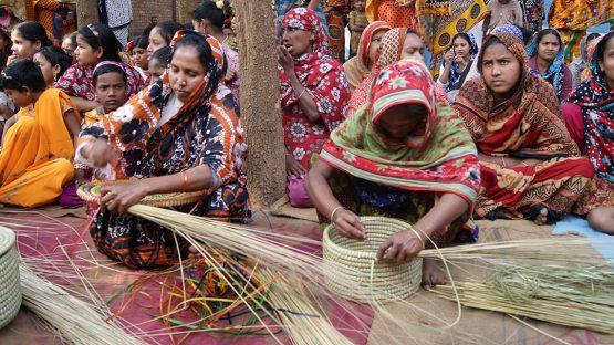 Women weaving kaisa grass baskets