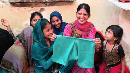 Reshma, a sewing student proudly shows her design