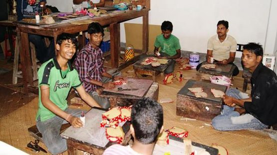 The Shanti Handcrafts group painting embossed leather