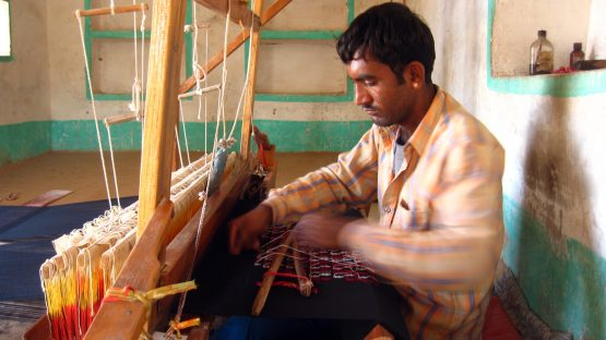 Phaladram Juiya weaving at his loom
