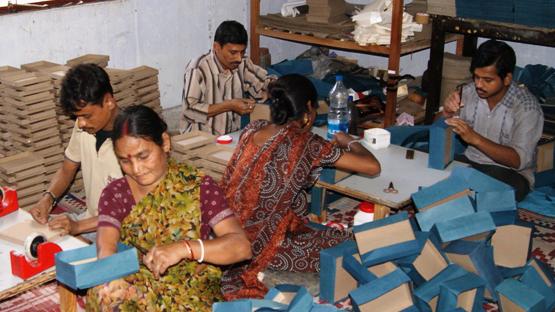 Artisans at work creating gift boxes