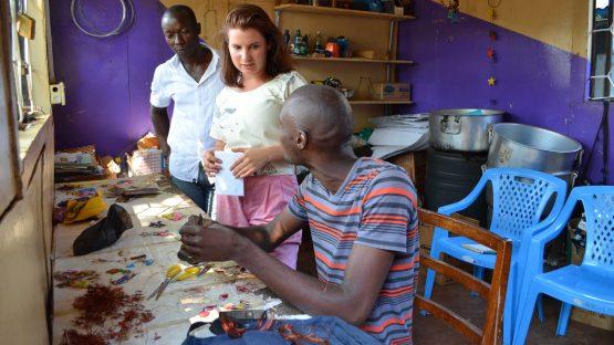 Trade Aid's Rosa with artisans Julius and Marcarius