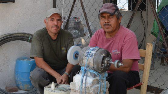 Benito and Elias polishing finished jewellery