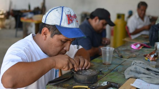 Tiofilo Alura creating silver jewllery