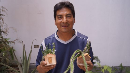 Julio, a cermic artisan showing his work