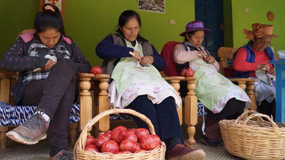 Women artisans carving gourds