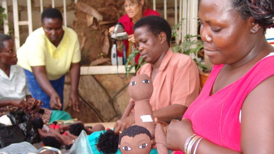 Women artisans making dolls