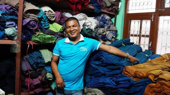 Naresh Magar sorting fabrics