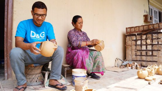Bikram Prajapati working with his mother Tej Kumari Prajapati in the family ceramics' business