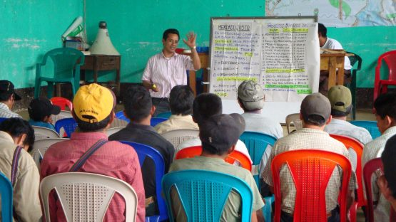 Coffee farmers receiving training about fair trade