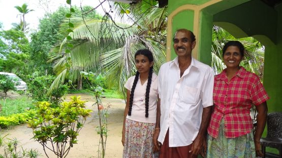 Spice farmers Dissanayake, his wife Anulawathie and their daughter