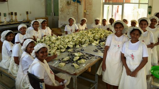 Young women in the spice packing unit