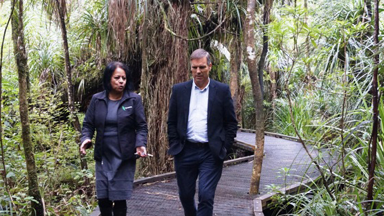 Te Roroa Honey Manager, Erana Clarkson, and Trade Aid CEO Geoff White in Waipoua Forest