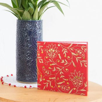 Red and gold floral card | TradeAid