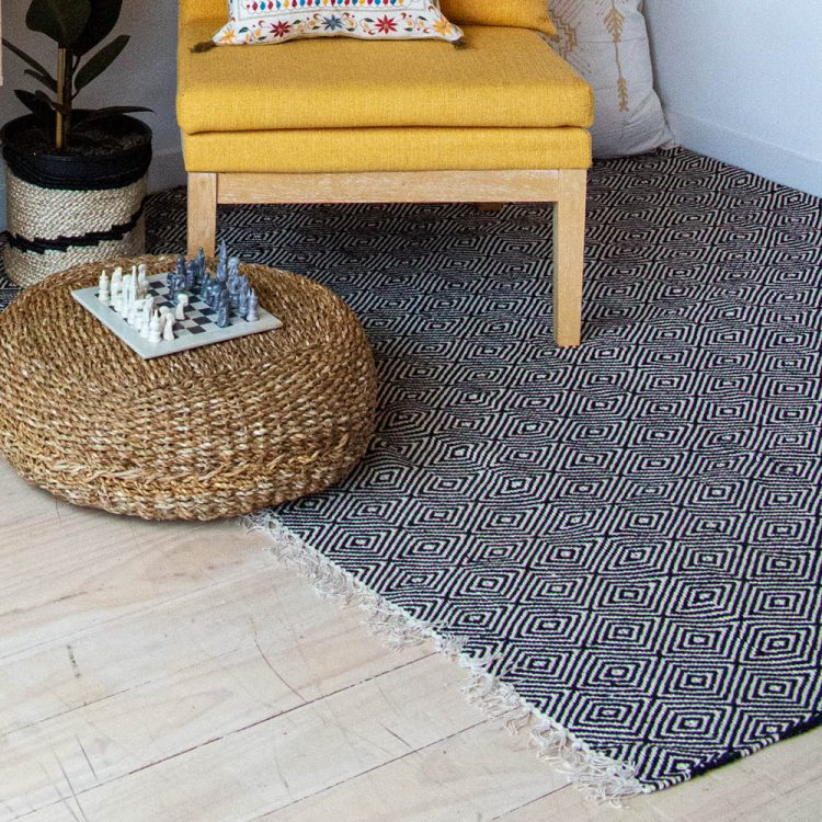 Large black and white rug with diamond design | TradeAid