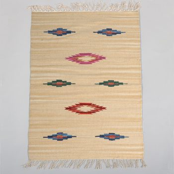 Small cream rug with coloured diamond design | TradeAid
