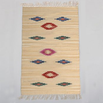 Medium cream rug with coloured diamond design | TradeAid