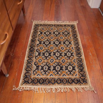 Small black and gold geometric rug | TradeAid