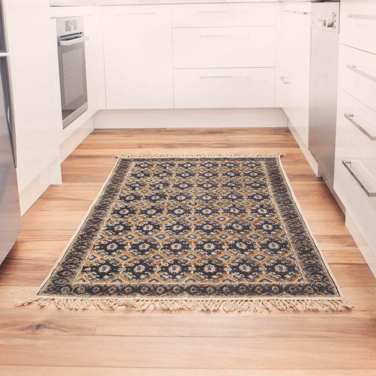 Medium black and gold geometric rug   TradeAid
