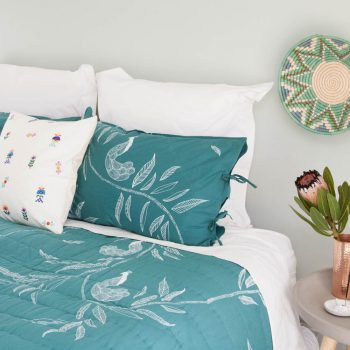 King leaf and peacock print quilt | TradeAid