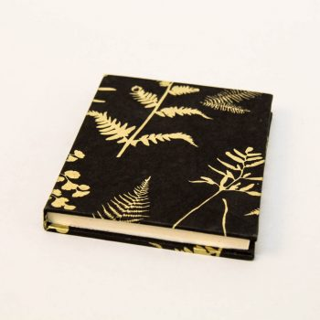 Notebook with black and gold fern design | TradeAid