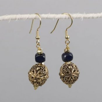 Antiqued brass earring with blue bone bead | TradeAid