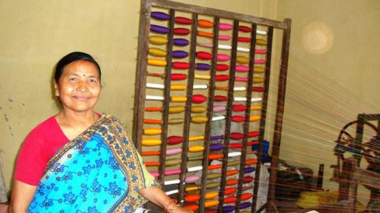 Laxmi, the weaving group leader, winding bobbins