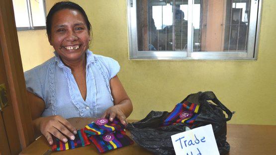 Esmirna Quel preparing an order for Trade Aid