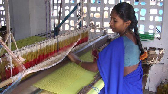 An artisan weaving beautiful fabrics