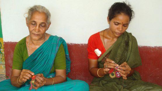 Two women artisans crocheting