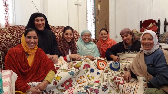 The women of ZDPM embroidering numdah rugs