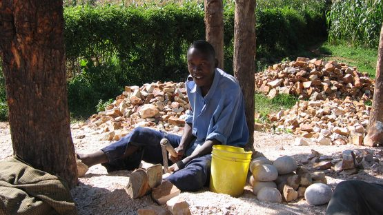 An Undugu producer cutting soapstone