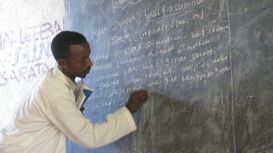 Mohammed Hassan teaching in a school funded by fair trade premiums