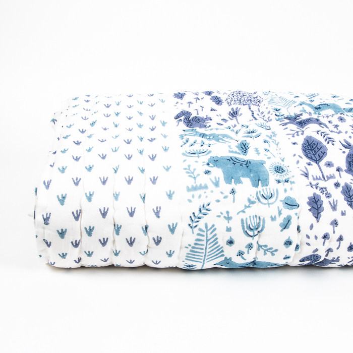 Single quilt with blue folk land print   TradeAid