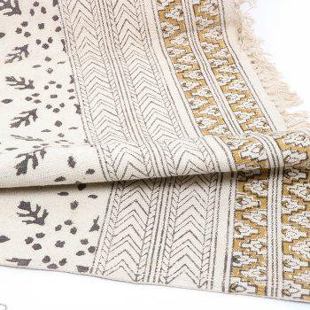 Black and mustard kalamkari rug | TradeAid