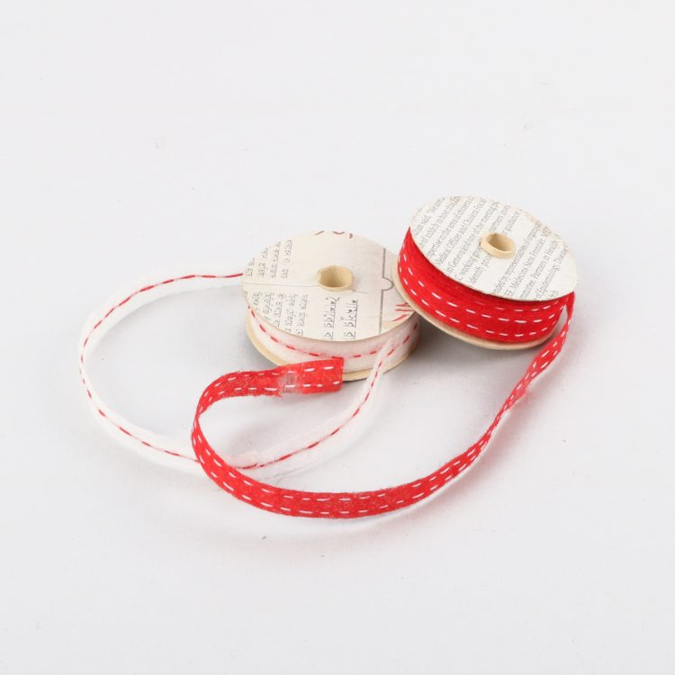 Set of 2 red and white stitched paper ribbon | TradeAid