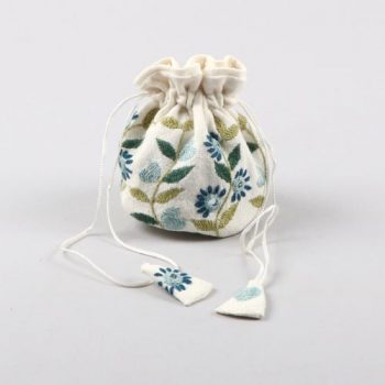 White jewellery pouch with floral embroidery | TradeAid