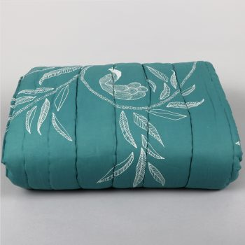 Queen quilt with leaf and peacock print | TradeAid