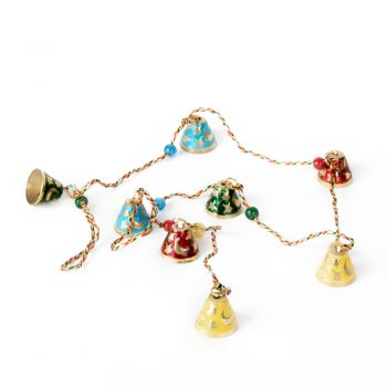 Meena work hanging bells | TradeAid