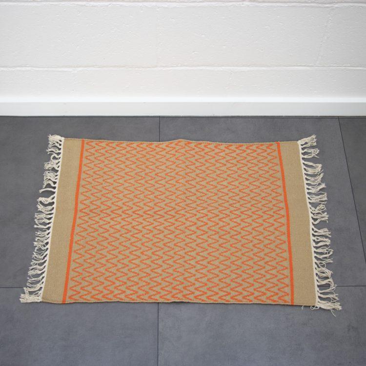 Orange zigzag rug   TradeAid