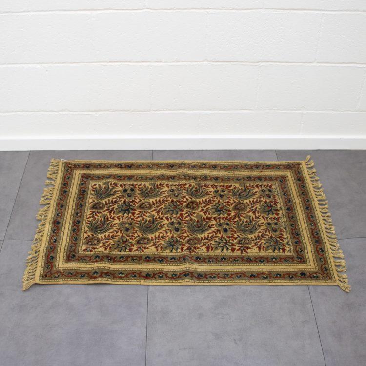 Henna flower rug   TradeAid